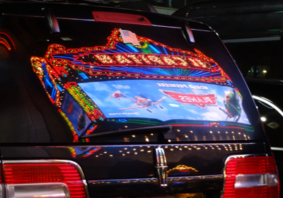 The El Captain Theatre marquee reflection in one of the VIP limousine windows