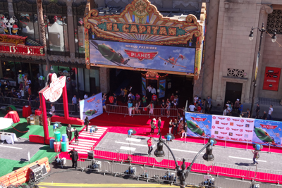 Workers prepare the red carpet for the Planes premiere